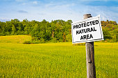 """Protected Natural Area"" written on a field sign - image with copy space"