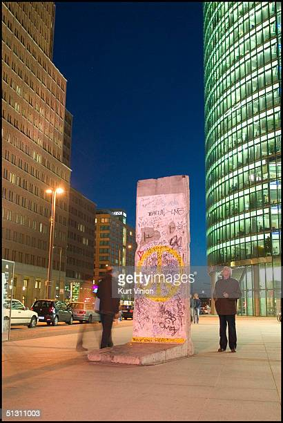 A protected piece of the Berlin Wall that was saved from being destroyed or carted off to a museum stands as a memorial in the heart of Berlin's...