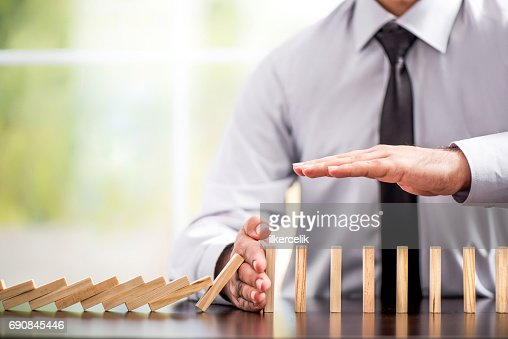 Protecting Assets From Domino Effect. Stop Loss Concept. : Stock Photo