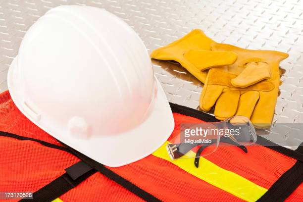 Protective construction workwear laid on metal surface