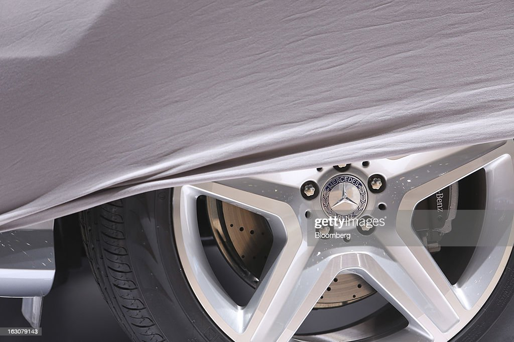 A protective cover sits across the wheel of a Mercedes-Benz automobile, produced by Daimler AG, ahead of the opening day of the 83rd Geneva International Motor Show in Geneva, Switzerland, on Monday, March 4, 2013. This year's show opens to the public on Mar. 7, and is set to feature more than 100 product premiers from the world's automobile manufacturers. Photographer: Chris Ratcliffe/Bloomberg via Getty Images