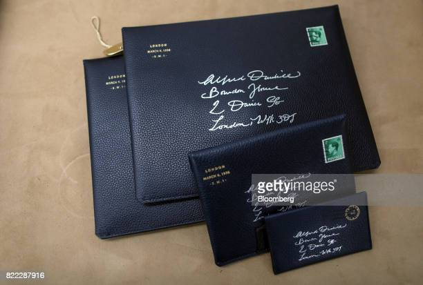 Protective leather pouches sit on a bench in the workshop at the Alfred Dunhill Ltd London Leather Workshop in London UK on Tuesday July 25 2017...