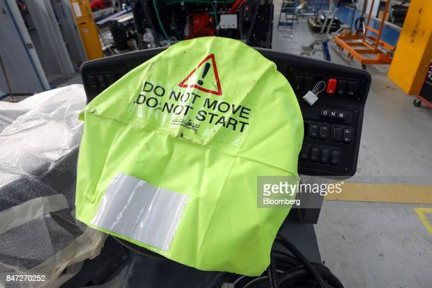 A protective warning sign covers the steering wheel of an Enviro 400 bus at the Alexander Dennis Ltd factory in Scarborough UK on Wednesday Sept 13...