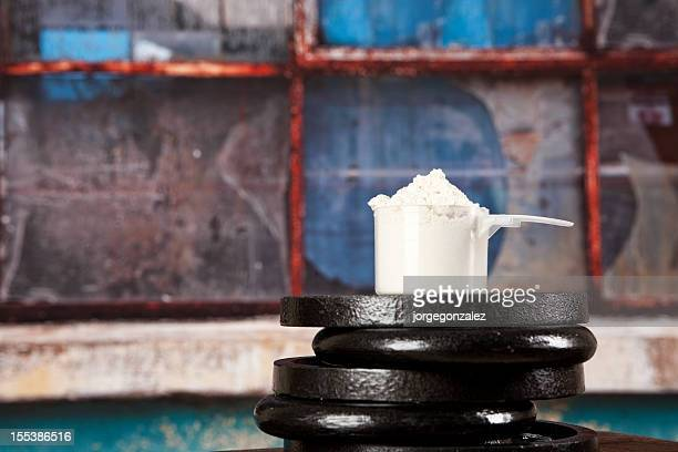 Protein powder with barbell weights