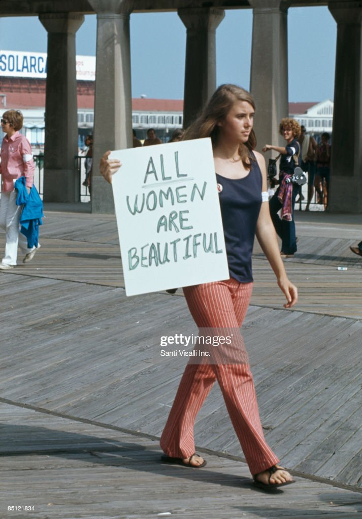A protest against the Miss America Pageant at Atlantic City New Jersey 6th September 1969 A woman walks past with a sign reading 'All women are...
