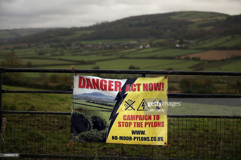 A protest banner against a new power line is displayed on a farm gate overlooking the Mendip Area of Outstanding National Beauty close to the village of Christon on November 6, 2012 in Somerset, England. The National Grid released today its draft Hinkley C to Avonmouth connection route which would involve replacing existing pylons with fewer but larger ones and will also use underground cables in the Mendip Area of Outstanding National Beauty. However campaigners how have been fighting against the new power line, have claimed the proposals will still have a detrimental effect on the landscape.