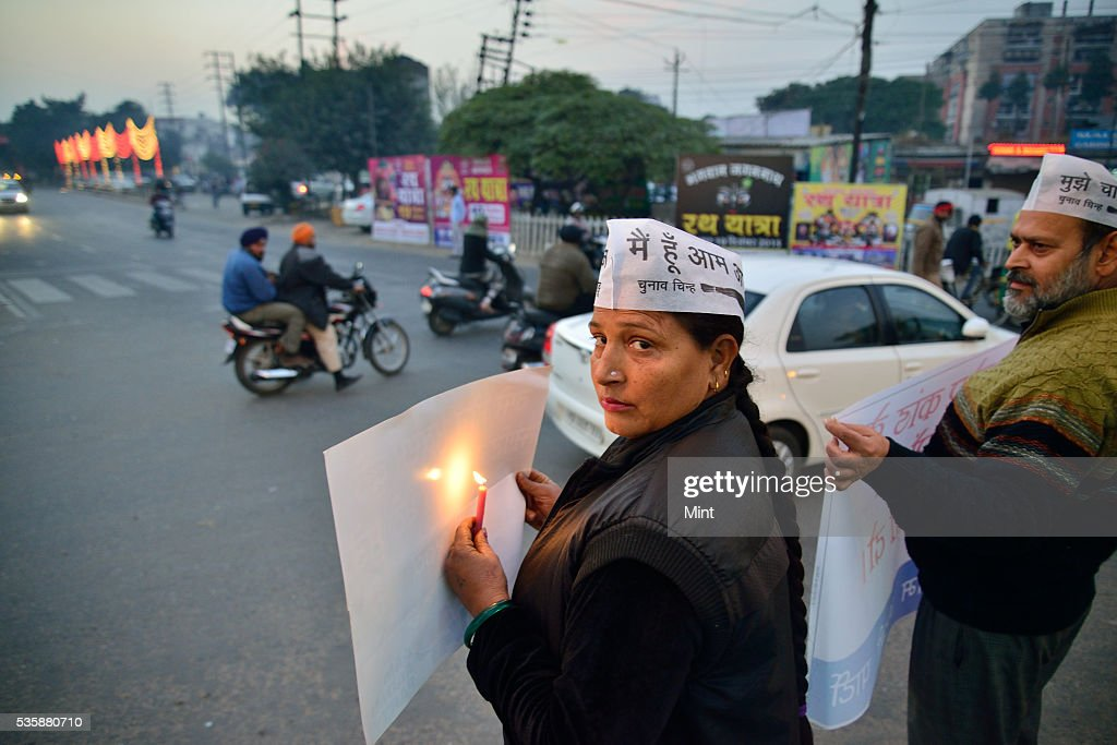 Protest by AAP party worker at Aarti Chowk at Ghumar Mandi on December 16, 2015 in Ludhiana, India. Punjab will go to the Assembly polls next year. What conventionally has been a two-sided contest between BJP-SAD and Congress is now set to turn into a triangular electoral fight by entry of Aam Aadmi Party.