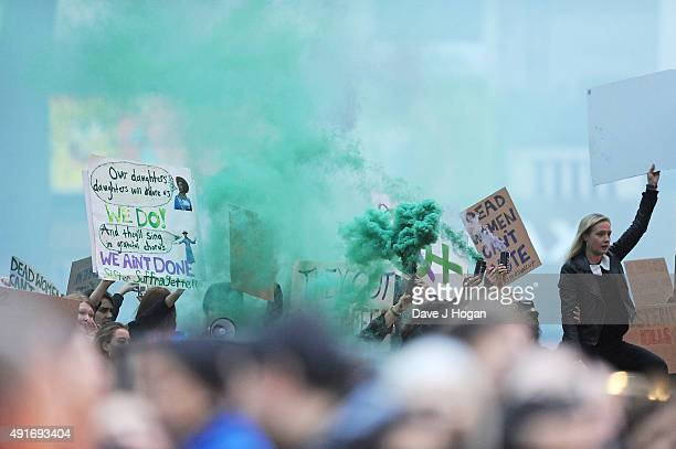A protest during the screening of 'Suffragette' on the opening night of the BFI London Film Festival at Odeon Leicester Square on October 7 2015 in...