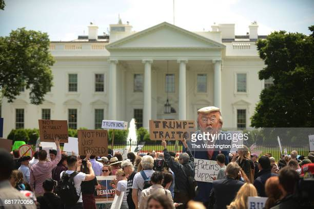 A protest is held outside White House in Washington DC May 10 to demand and independent investigation into Trump ties with Russia following the...
