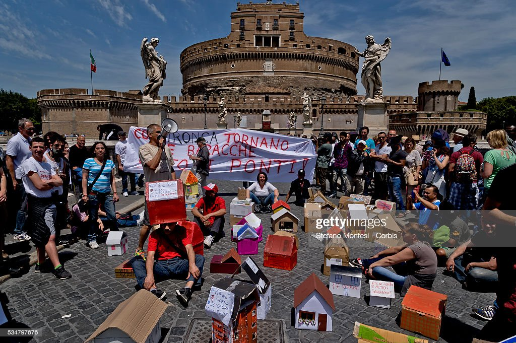 Protest of 'Action Rights in motion' that occupies Ponte Sant'Angelo bringing small cardboard houses for a few hours against the policy of evictions and speculation of Francesco Paolo Tronca,Special Commissioner of Rome on May 26, 2016 in Rome, Italy.
