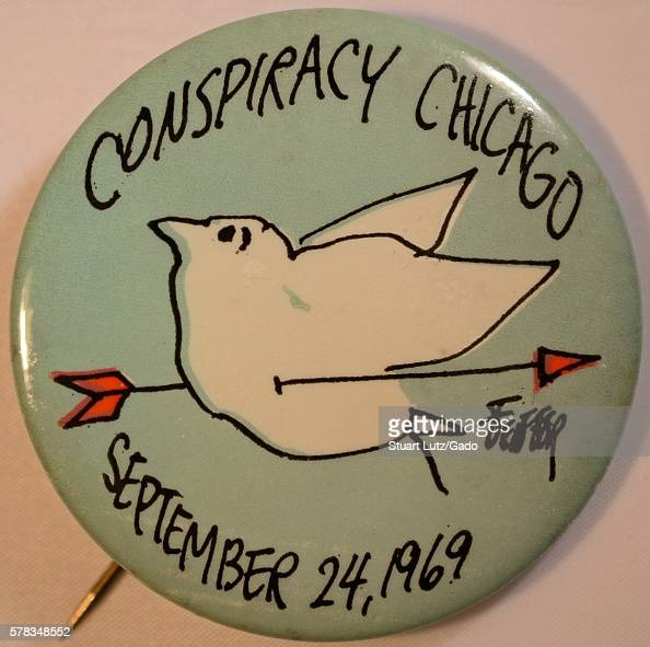 A protest pin that supports the Chicago 7 it contains the text 'Conspiracy Chicago' and 'September 24 1969' which was the start date of the trial for...