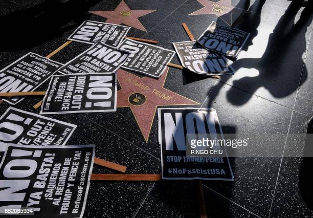 Protest posters are placed at President Donald Trump's star on the Hollywood Walk of Fame as members of Refuse Fascism protest the firing of FBI...