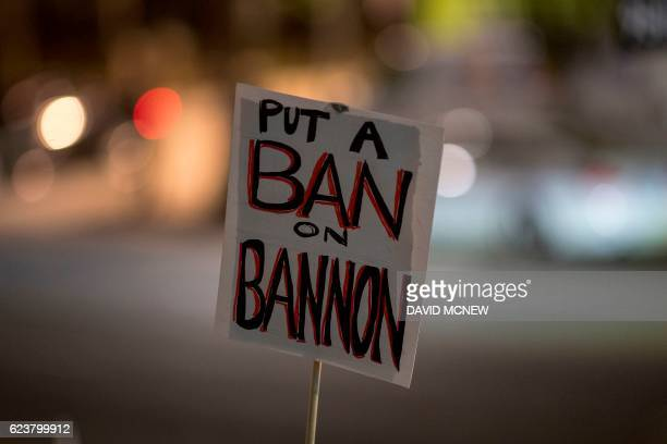 A protest sign is held in the air at a protest against the appointment of white nationalist altright media mogul former Breitbart News head Stephen...