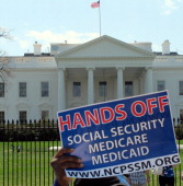 A protest sign is held up in front of the White House on April 9 in Washington DC where liberal advocacy opposed changes to Social Security benefits...
