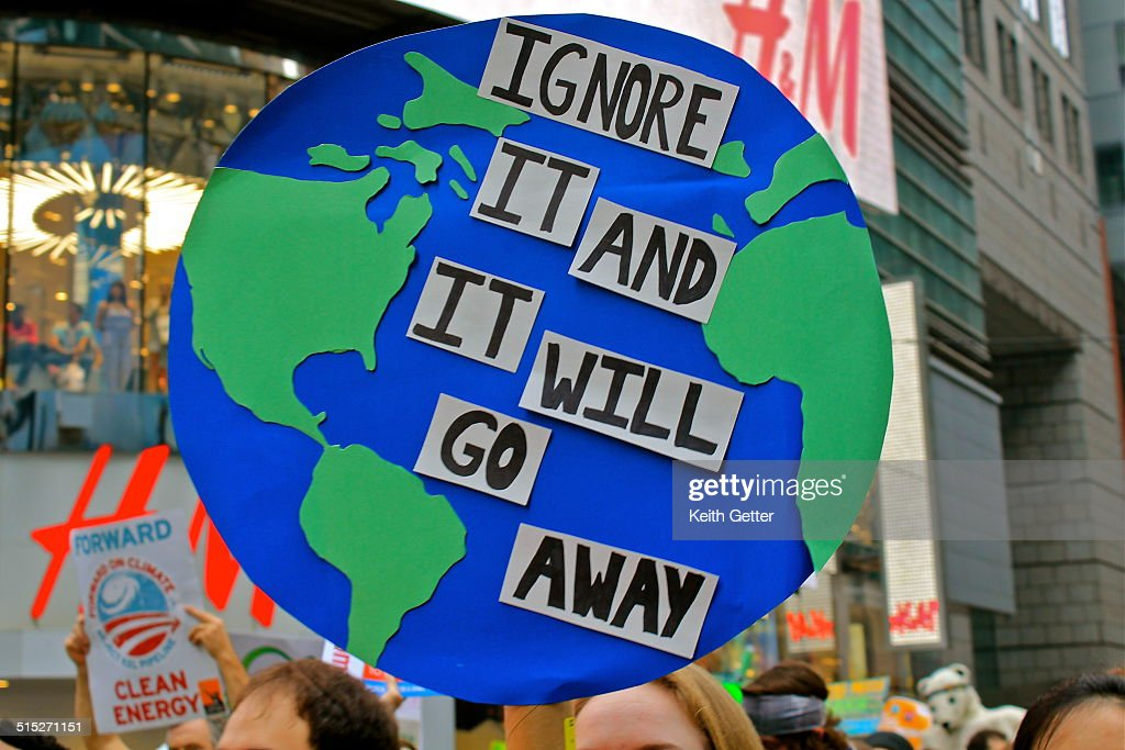 Protest Sign shaped like Planet Earth at the People's Climate March NYC Sept 21 2014