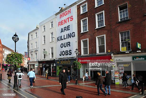 A protest sign which reads 'High rents are killing our jobs' hangs from a building in Grafton Street Dublin Ireland on Thursday Nov 4 2010 Ireland is...
