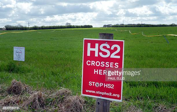 Protest signs mark a field site where the track line of the High Speed 2 railway is planned to pass through near Lymm west of Manchester northwest...