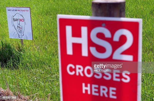 Protest signs mark a field where the track line of the High Speed 2 railway is planned to pass through near Lymm west of Manchester northwest England...