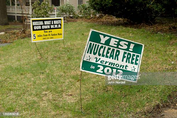 Protest signs on yard for a Nuclear Free Vermont in Brattleboro, Vermont, USA on Tuesday, 26 April 2011. Six miles from these homes is the Vermont Yankee nuclear power plant. Vermont Yankee's reactor is the same model as those at the troubled Fukushima D