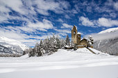 Protestant church San Gian with unrestored tower in Celerina near St. Moritz, Canton Grison, Switzerland