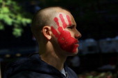 A protester affiliated with Occupy Wall Street demonstrates at Zuccotti Park near the New York Stock Exchange on the second anniversary of the...