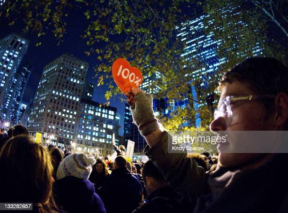 A protester affiliated with the Occupy Wall Street holds a sign in Foley Square on November 17 2011 in New York City Protesters gathered in Foley...