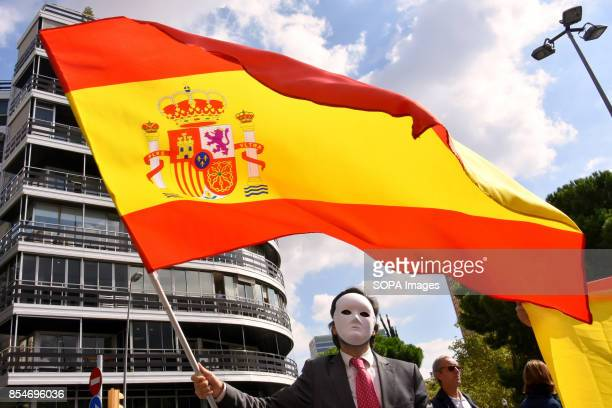 RàDIO BARCELONA CATALONIA SPAIN A protester against the independence of Catalonia is pictured while wearing a white mask to cover his face and...