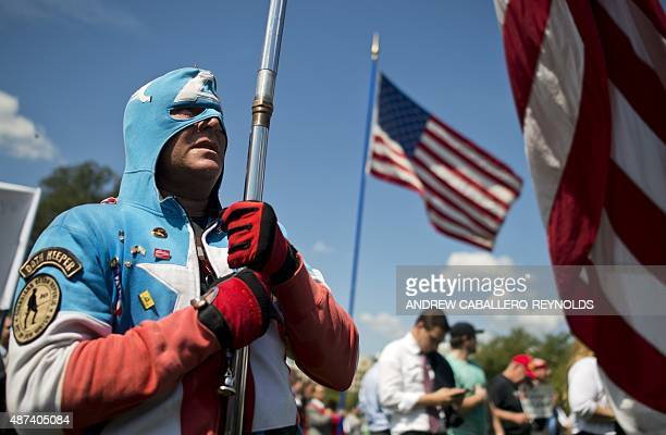 A protester against the international nuclear agreement with Iran stands at attention during the National Anthem at a Tea Party rally outside the US...