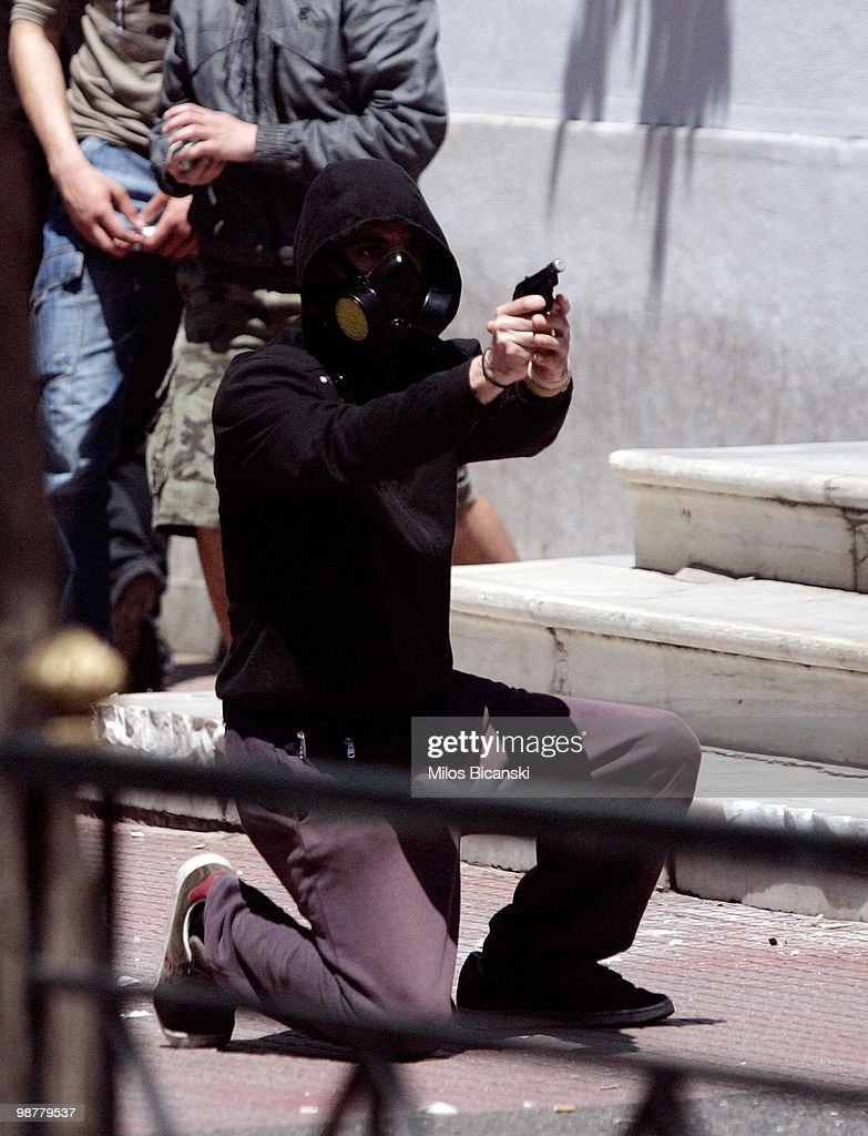 A protester aims a flare gun at the police during May Day protests on May 1, 2010 in Athens, Greece. Thousands of protesters gathered in Athens and other Greek cities to participate in May Day rallies, angered by the harsh austerity measures demanded by the EU. Reports suggest that the 45 billion euros ($60 billion) already pledged by the International Monetary Fund and European Union will be insufficient to tackle Greece's mounting debt crisis.