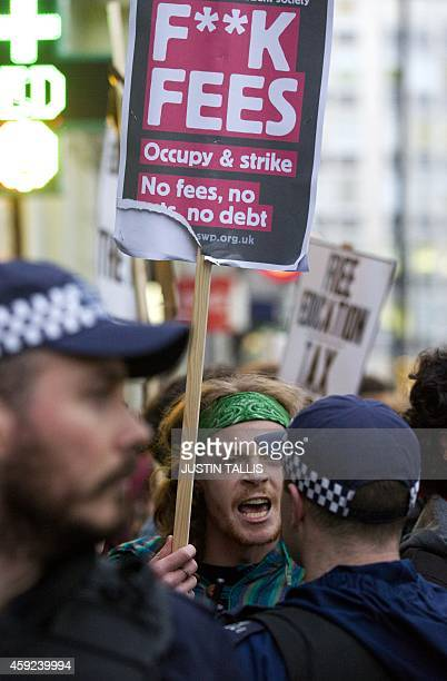 A protester argues with a police officer during a student march against university fees in Central London on November 19 2014 The demonstration...