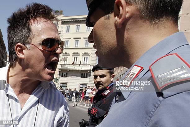 A protester argues with a policeman during a demonstration of workers of the Italian carmaker Fiat to protest against the restructuration of Fiat...