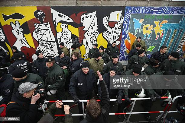 A protester argues with police at the East Side Gallery which is the longest stillstanding portion of the former Berlin Wall following efforts by a...