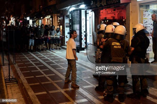 TOPSHOT A protester argues with riot police during an antifascism demonstration in Thessaloniki on September 18 2017 Hundreds of people joined an...