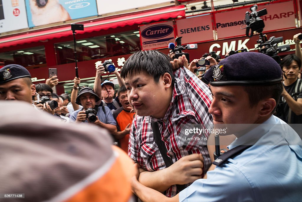 A protester arrested by police after clash with local residents during protest in Sheung Shui on May 1, 2016 in Hong Kong, Hong Kong. Hundreds gathered in Hong Kong on Labor Day, demanding better workers' rights while voicing out their resentment against mainland travellers in Hong Kong.