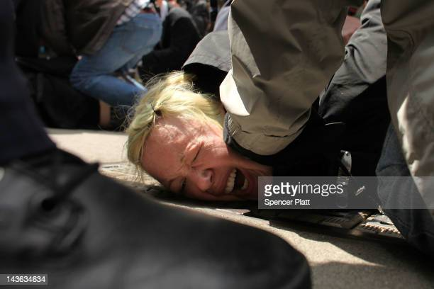 A protester associated with the Occupy Wall Street movement is arrested while marching through traffic in lower Manhattan on May 1 2012 in New York...