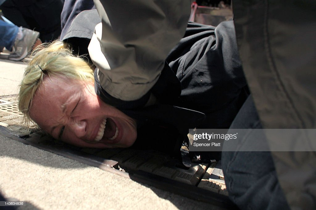 A protester associated with the Occupy Wall Street movement is arrested while marching through traffic in lower Manhattan on May 1, 2012 in New York City. May 1st, Labor Day, is a traditional day of global protest in sympathy with union and leftist politics.