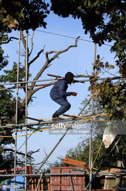 A protester at the Dale Farm travellers site at Cray's Hill near Basildon Essex where bailiffs will later this morning begin to forcibly eject the...