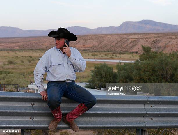 Protester Brooks Atwood from east Texas sits on a guard rial and talks on a phone at a protest camp along US highway 170 protesting the closure of...