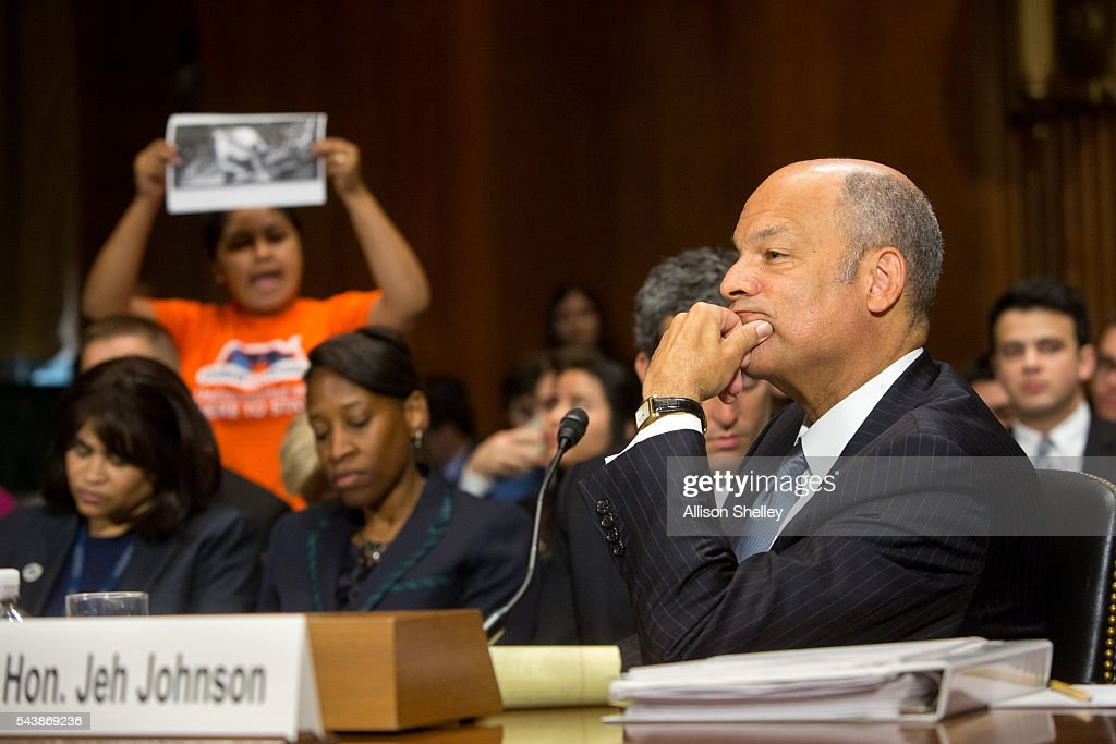 A protester calling for the end of deportations interrupts a Senate Judiciary Committee hearing on oversight of the Department of Homeland Security as Homeland Security Chief <a gi-track='captionPersonalityLinkClicked' href=/galleries/search?phrase=Jeh+Johnson&family=editorial&specificpeople=5862084 ng-click='$event.stopPropagation()'>Jeh Johnson</a> testifies, on June 30, 2016 in Washington, DC.