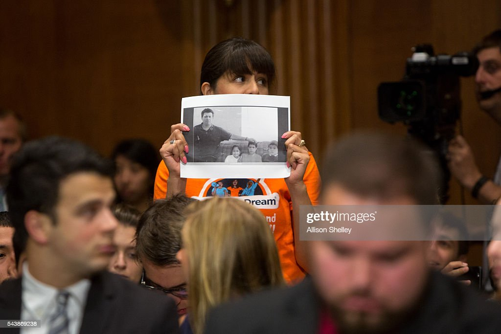 A protester calling for the end of deportations interrupts a Senate Judiciary Committee hearing on oversight of the Department of Homeland Security as Homeland Security Chief Jeh Johnson testifies, on June 30, 2016 in Washington, DC.