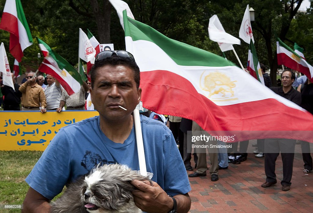 A protester carries a dog and an Iranian flag during a rally July 11, 2009 in Washington, DC. Activists gathered to rally for the current uprising in Iran over the recent elections.