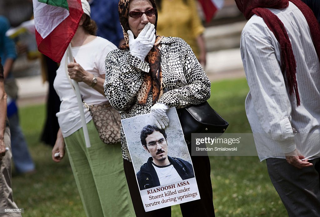A protester carries a photo of a student during a rally July 11, 2009 in Washington, DC. Activists gathered to rally for the current uprising in Iran over the recent elections.
