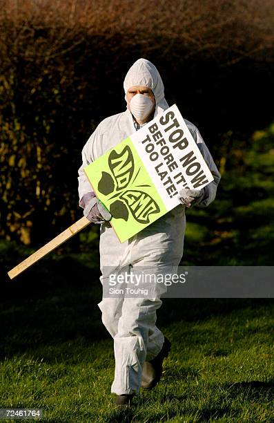 A protester carries an antiGM banner March 9 2002 at a demonstration against genetically modified crops at a farm in Long Marsden in Warwickshire...