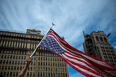 A protester carries an upside down United States flag outside City Hall in Philadelphia on July 26 2016