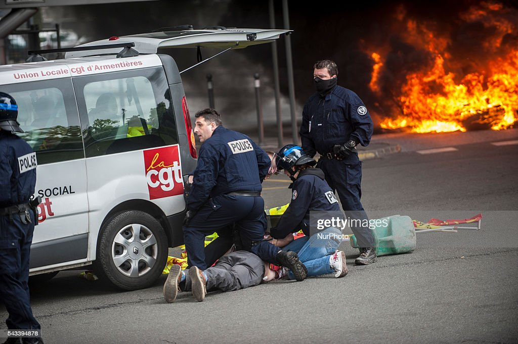 A protester CGT was arrested after police intervention around the roundabout on fire stations in Lille, France on june 28, 2016. A new national day of action against labor law place throughout France. Economic blocking action was planned by the CGT in Lille this morning at 6:30 am.