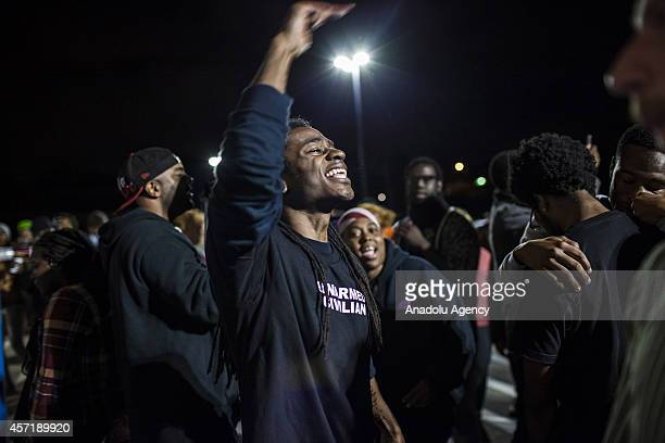 A protester chants slogans during the demonstrations outside a Walmart shop in the St Louis region during the Moral Mondays day of Civil Disobedience...