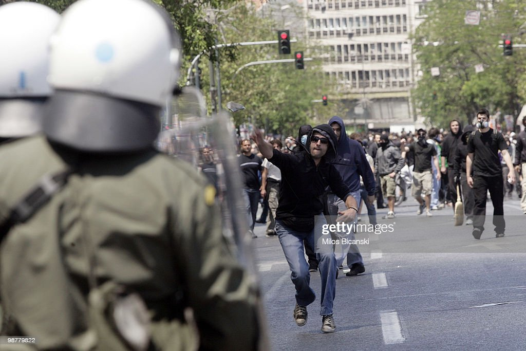 A protester clashes with riot police during May Day protests on May 1, 2010 in Athens, Greece. Thousands of protesters gathered in Athens and other Greek cities to participate in May Day rallies, angered by the harsh austerity measures demanded by the EU. Reports suggest that the 45 billion euros ($60 billion) already pledged by the International Monetary Fund and European Union will be insufficient to tackle Greece's mounting debt crisis.