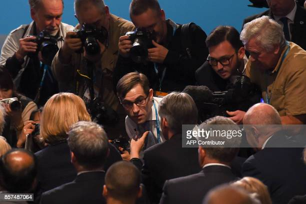Protester comedian Simon Brodkin speaks to Britain's Home Secretary Amber Rudd and Britain's Chancellor of the Exchequer Philip Hammond after...