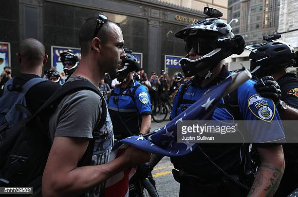 A protester confronts an Akron police officer during a demonstration near the site of the Republican National Convention on July 19 2016 in Cleveland...