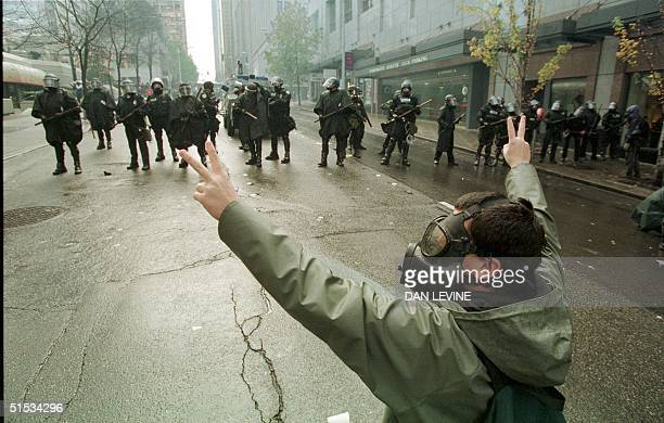 A protester confronts Seattle police after they fired tear gas to disperse demonstrators in downtown Seattle Washington 30 November 1999 The WTO...